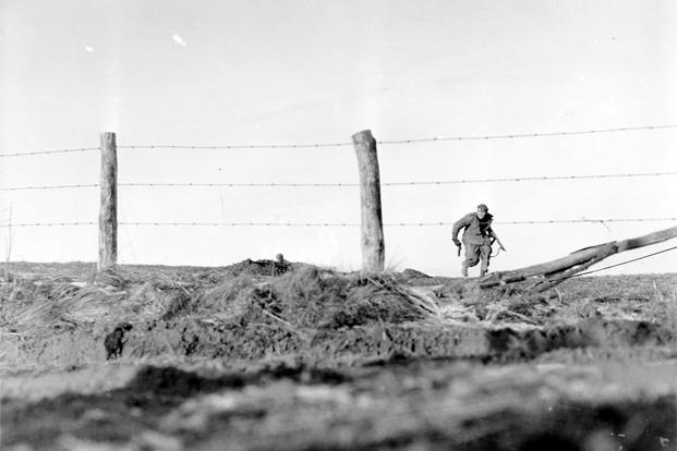 Infantryman goes out on a one-man sortie, covered by a buddy in the background. 82nd Airborne Div., Belgium. Dec. 24, 1944. (Photo: National Archives)
