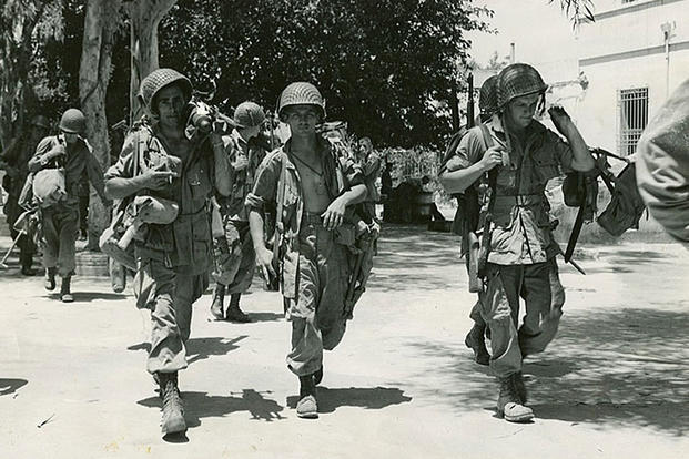 Members of the 504th Parachute Infantry Regiment patrol Sicily after capturing the island from Germany in early July, 1943. (U.S. Army photo)