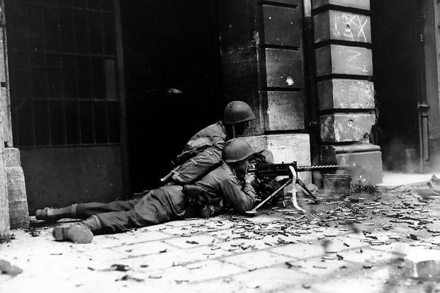 A GI machine gun crew  in the streets of Aachen, Germany, October 15, 1944. (U.S. Army photo)