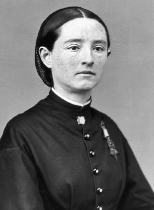 Mary E. Walker sitting with Medal of Honor.
