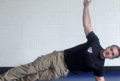 Stew Smith demonstrating side plank.