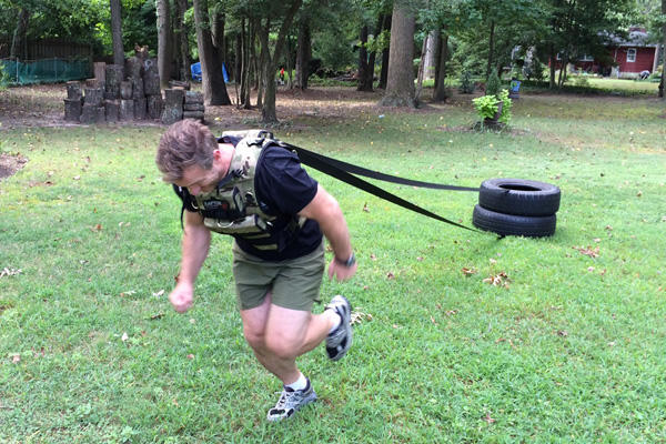 Stew Smith: Tire pull with Raptor harness.