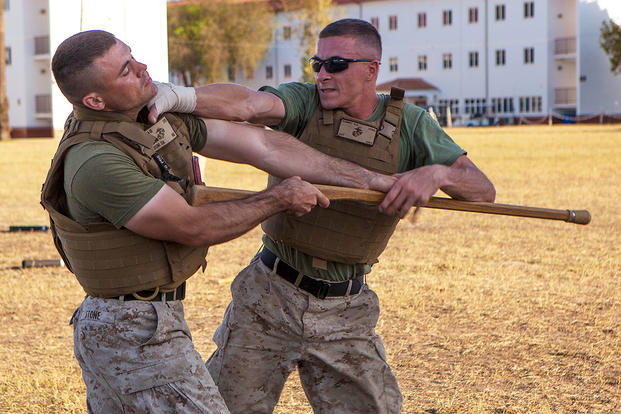 U.S. Marine Corps Sgt. Sean Kinney blocks a bayonet trainer and chokes his opponent, Cpl. Steven Stone. (U.S. Marine Corps photo by 1st Lt. Gerard R. Farao)