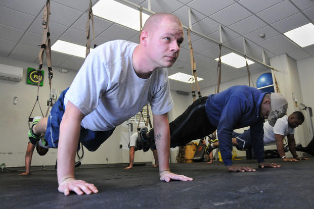 Tech Sgt. Matt B. Halstead performs pushups during a TRX Suspension Training program held at Dobbins' Human Performance Center. (U.S. Air Force photo/Senior Airman Andrew J. Park)