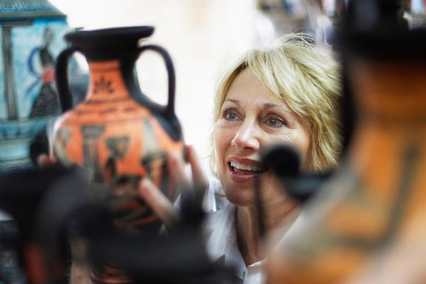 woman shopping for a vase