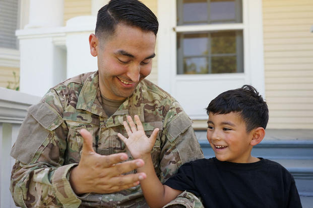 Serviceman and son