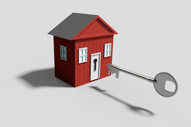 Illustration of a key opening a house