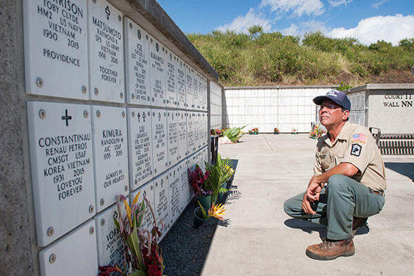 Chris Farley, U.S. Navy veteran and National Memorial Cemetery of the Pacific caretaker, reads the names of fallen service members at the cemetery in Honolulu.  (U.S. Air Force/Staff Sgt. Christopher Hubenthal)