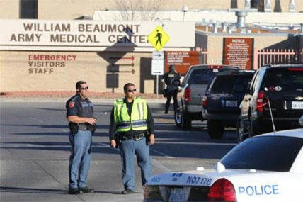 olice officers guard an entrance to the Beaumont Army Medical Center/El Paso VA campus during the search for a gunman Tuesday, Jan. 6, 2014. (AP Photo/The El Paso Times, Victor Calzada)
