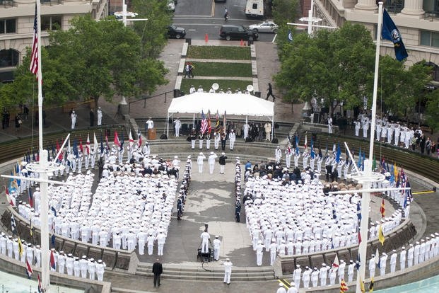 A sea of white uniforms greets visitors to the Navy Memorial in Washington, D.C as Sailors pause to celebrate the 73rd anniversary of the Battle of Midway. (U.S. Navy photo by Mass Communication Specialist 2nd Class Eric Lockwood/Released)