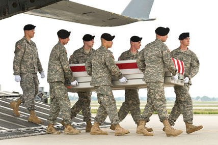 An Army carry team transfers remains at Dover Air Force Base, Del.
