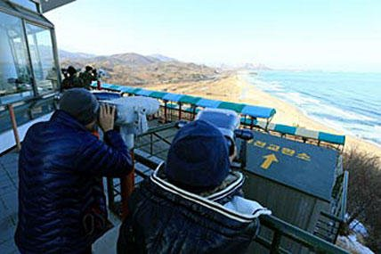 South Koreans use binoculars to look at Diamond Mountain in North Korea after news broke of North Korea's rocket launch at the Unification Observation post in Goseong, South Korea, Wednesday, Dec. 12, 2012.