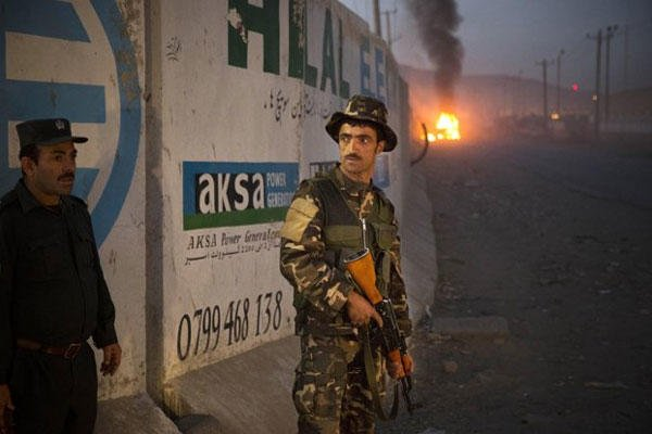 Afghan police secure the area after a car bomb detonated outside an ISAF civilian personnel compound in Kabul, Afghanistan, Friday, Oct 18, 2013.