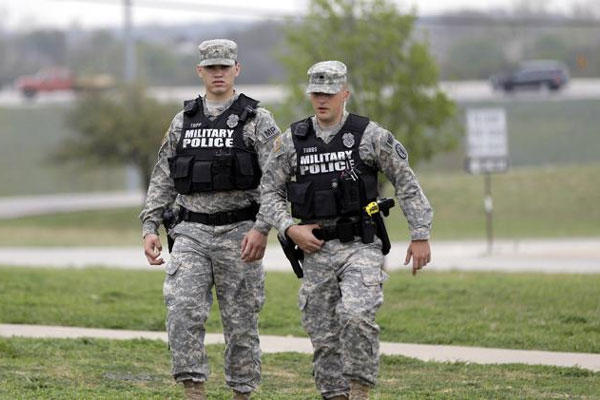 Military police patrol near Fort Hood's main gate, Thursday, April 3, 2014, in Fort Hood, Texas. (AP Photo/Eric Gay)