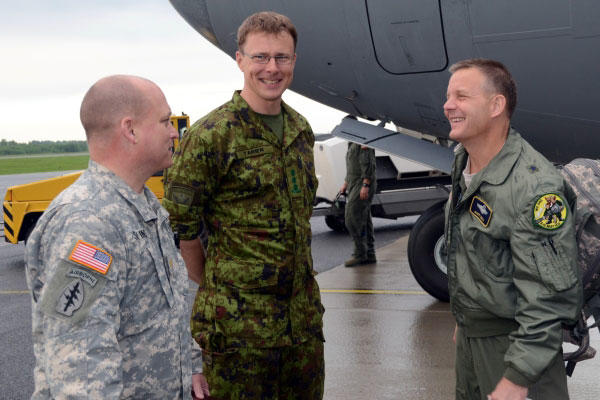 Caption: Col. Jaak Tarien (center), commander of the Estonian air force, greets Army and Air Force officials after they arrive at Amari Air Base, Estonia on May 31, 2013 for an exercise. (U.S. Air Force)