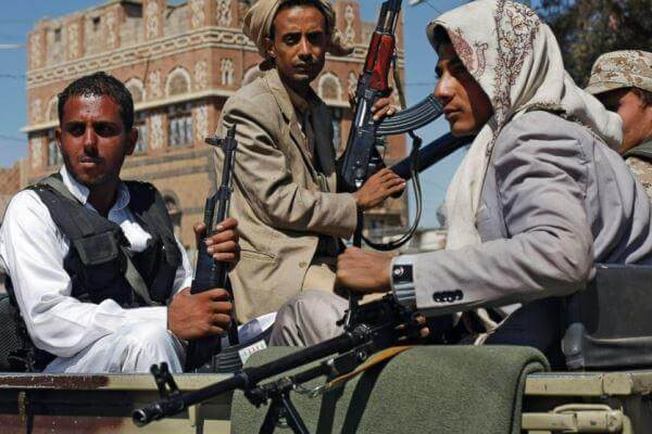 Houthi Shiite rebels ride in a military truck while patrolling a street in Sanaa, Yemen. (AP photo)