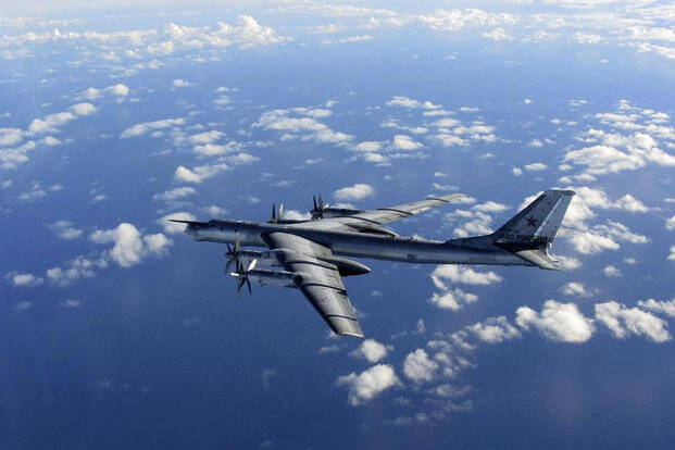 File photo provided by Britain's Royal Air Force of a Russian military long range bomber photographed by an intercepting RAF quick reaction Typhoon (QRA) as it flies in international airspace. (AP Photo/Royal AIr Force)