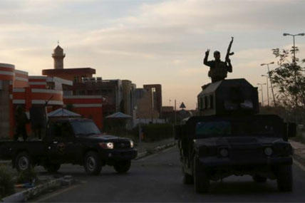 Iraqi security forces patrol at Tikrit University in Tikrit, 80 miles north of Baghdad, Iraq, Thursday, March 12, 2015. (AP Photo/Khalid Mohammed)