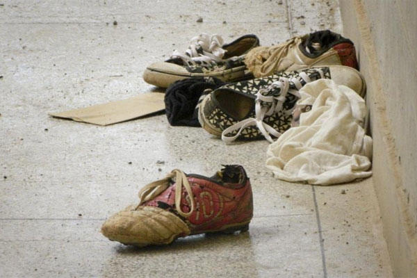 Abandoned shoes lie next to the Elgon A hostel inside the Garissa University College compound that was the scene of last week's attack by al-Shabab gunmen, in Garissa, Kenya Monday, April 6, 2015. (AP Photo)