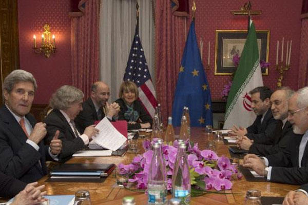 In this file photo dated March 19, 2015, US Secretary of State John Kerry holds a negotiation meeting with Iran's Foreign Minister Javad Zarif over Iran's nuclear program, in Lausanne, Switzerland. (AP Photo/Brian Snyder)
