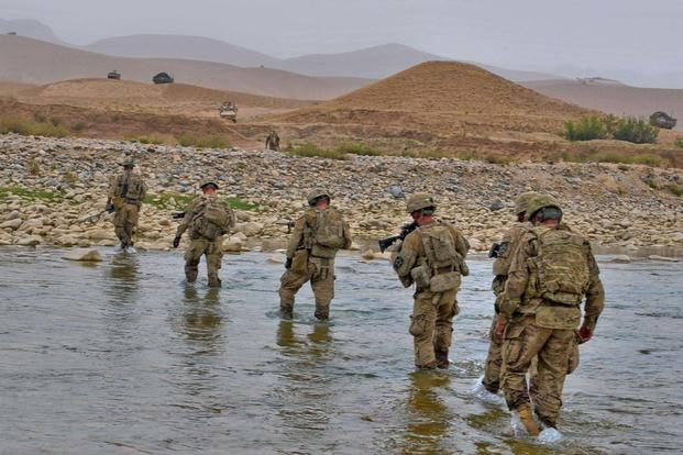 Task Force Arrowhead Soldiers make their way back across the Arghandab River in the Mizan district of southern Afghanistan under the watchful eyes of their fellow Soldiers, Sept. 5, 2012.. (Photo Credit: Sgt. Matt Young)