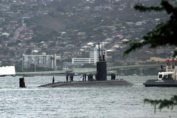The submarine USS Greeneville is escorted to the submarine base at Pearl Harbor, in this Feb. 10, 2001, file photo.