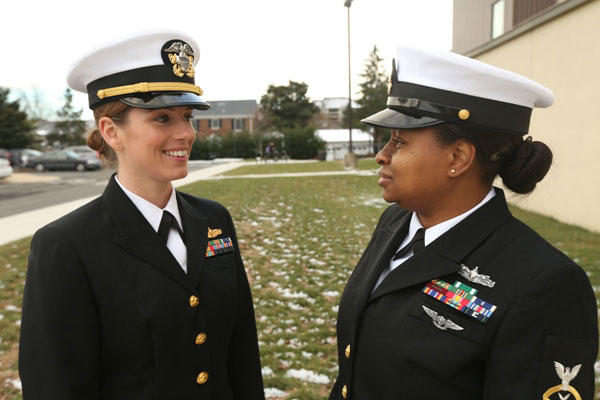 Lt. Heidi Boettger and Chief Petty Officer Brianne Dentson model a prototype for the female combination cover, redesigned to more closely resemble the male version. (Elliott Fabrizio/U.S. Navy)