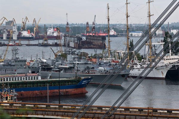 In this photo taken on Wednesday, May 14, 2014, Ukraine's navy ships are docked along with cargo vessels in Odessa, Ukraine. (AP Photo)