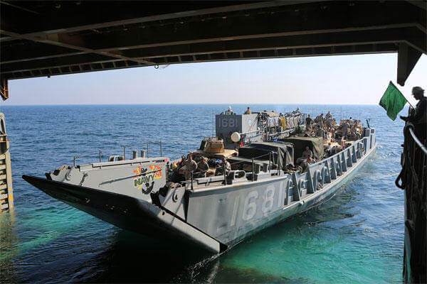 A landing craft utility exits the well deck of the amphibious dock landing ship USS Comstock to transport Marines and Sailors assigned to the 11th MEU and Comstock ashore. (U.S. Marine Corps photo by Sgt. Melissa Wenger/Released)
