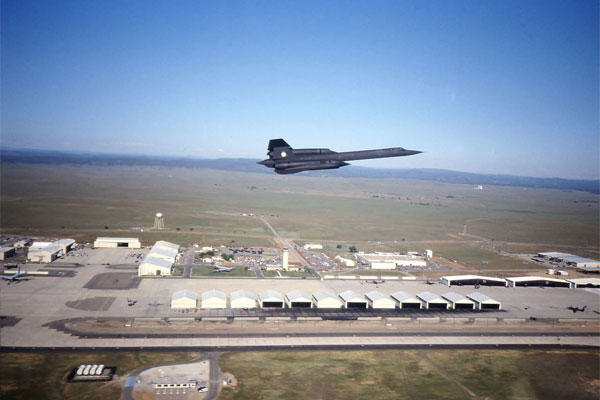A SR-71 Blackbird flies over Beale Air Force Base in an undated photo. Blackbird hangars are clearly visible in lower portion of the photo. (Courtesy photo)