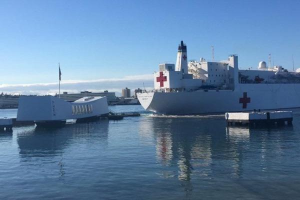 The photo shows the USNS Mercy sailing dangerously close to the USS Arizona Memorial. (Photo by Navy sailor)