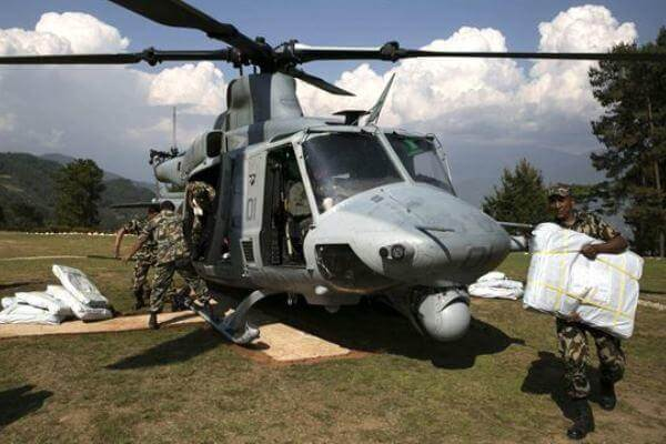 Nepalese military service members unload supplies from a UH-1Y Huey in Charikot, Nepal on May 5. (Marine photo)