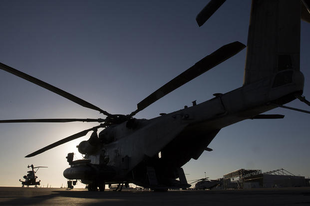 A CH-53E Super Stallion with Marine Heavy Helicopter Squadron 466 waits on the flightline as aircrew Marines conduct preflight checks at Marine Corps Station Miramar, Calif., Sept. 16. Photo By: Sgt. Lillian Stephens