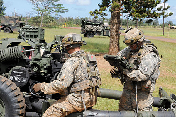 Soldiers adjust their M119A3 howitzer as they occupy a firing point on Area X-Ray during Exercise Lightning Forge in March. (U.S. Army/Sgt. Brian C. Erickson)
