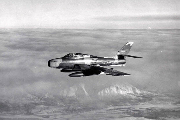 "Republic F-84F-25-RE (S/N 51-1747) of the 162nd Tactical Fighter Squadron during Operation ""Punchcard IV."" Note the open drag chute door -- the chute was lost during flight (accidentally deployed!). (U.S. Air Force photo)"