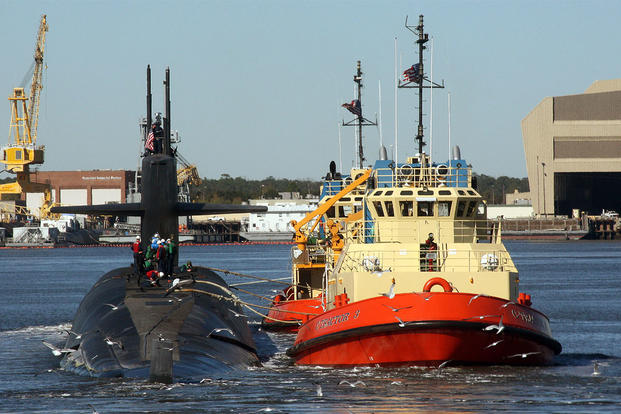 The ballistic-missile submarine USS Rhode Island (SSBN 740) is escorted by tug boats to her berth at Naval Submarine Base Kings Bay, Ga. (US Navy Photo)