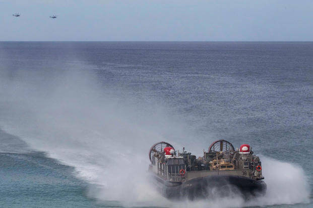 A landing craft air-cushion, or LCAC, transporting U.S. Marines and Portuguese Marines moves towards Pinheiro Da Cruz, Praia Da Raposa beach, Portugal, to participate in a combined amphibious assault exercise, Oct. 20, 2015. (Photo by: Sgt. Austin Long)