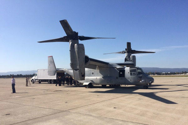 FEMA and Marine Corps officials practice loading gear onto a Marine Corps MV-22 on Tuesday at Moffett Field in California during a training exercise as part of Fleet Week San Francisco.(Photo: Military.com)