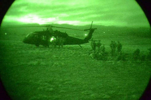 Soldiers at Fort Carson, Colorado, prepare to load onto a UH-60 Black Hawk from 4th Combat Aviation Brigade during a nighttime air assault training mission April 8, 2015. Army photo by Jonathan C. Thibault