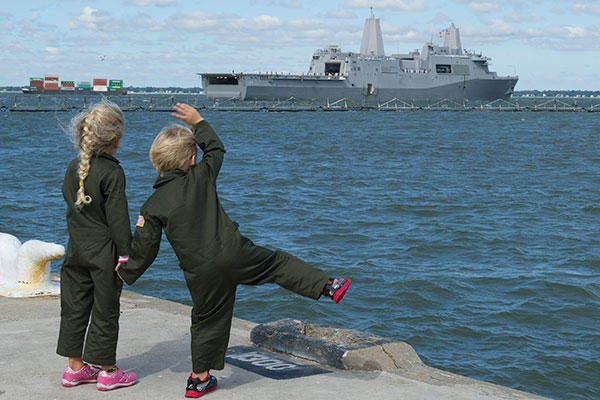 Children wave goodbye to their father, Lt. Chris Robinson, deploying aboard the amphibious transport dock USS Arlington (LPD 24). (U.S. Navy photo by MC Seaman Amy M. Ressler)