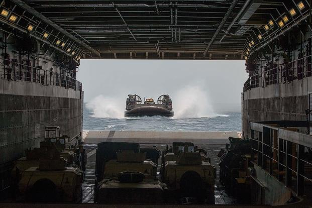 A landing craft air cushion (LCAC) attached to Assault Craft Unit (ACU) 5 enters the well deck of the San Antonio-class amphibious transport dock ship USS Anchorage (LPD 23).  (Photo by Mass Communications Specialist 2nd Class Matthew Dickinson)