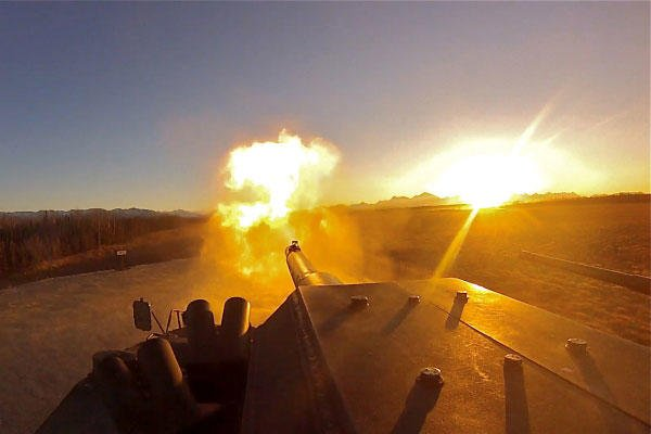 Flames erupt from the barrel of an M1128 Mobile Gun System as the sun sets over Alaska's Donnelly Training Area during the 1st Stryker Brigade Combat Team, 25th Infantry Division's MGS exercise Oct. 25, 2013. (Defense Department photo/Austin Buettgenbach)