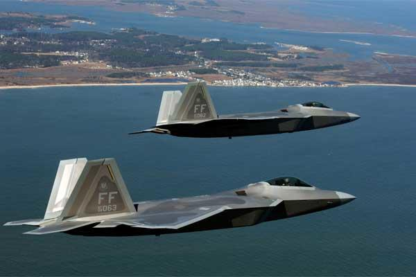 Two F-22 Raptors move into the Langley Air Force Base pattern Friday, March 3, 2006 (U.S. Air Force photo/Tech. Sgt. Ben Bloker)