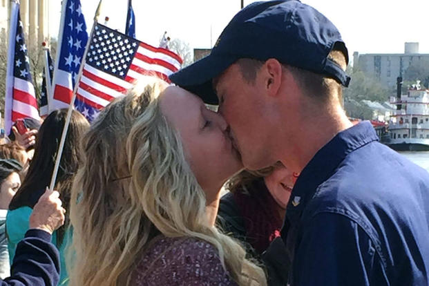 Petty Officer 3rd Class Philip Wert reunites with his fiancée during the Cutter Diligence homecoming March 5, 2016 in Wilmington, North Carolina. (U.S. Coast Guard photo: Mary Ann Holmes/Atlantic Area Ombudsman)
