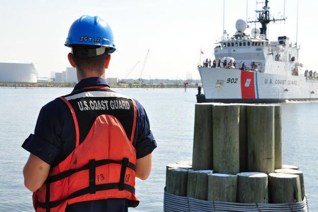 A Coast Guard member waits on the pier for the Coast Guard Cutter Tampa at Base Portsmouth, Virginia, April 27, 2016. (Photo: Petty Officer 1st Class Melissa Leake)