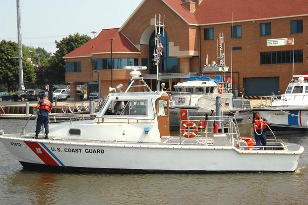 The 41-foot response boat 41410 and its crew begin a journey back to Coast Guard Station Muskegon, Mich., following its decommissioning ceremony at Station Grand Haven, Mich., July 31, 2014. (Photo: Chief Petty Officer Alan Haraf)