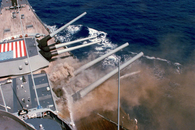 A photo taken from the bridge captures the explosion of the No. 2 16-inch gun turret aboard the USS Iowa (BB-61). (U.S. Navy photo)