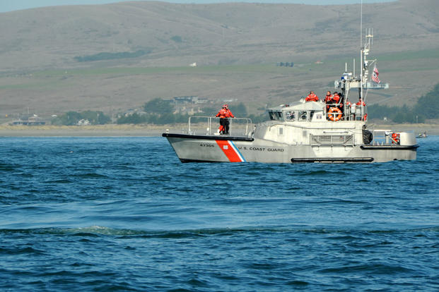 A crew aboard a 47-foot Motor Life Boat, from Station Bodega Bay await the next drill during a multi-agency training exercise, Nov. 17, 2010. (U.S. Coast Guard photo/Petty Officer 3rd Class Levi Read)