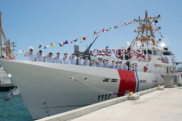 The crew of the U.S. Coast Guard Cutter Donald Horsley salutes as the ship is brought to life during its commissioning at Coast Guard Sector San Juan, Puerto Rico May 20, 2016. (U.S. Coast Guard photo/Ricardo Castrodad)
