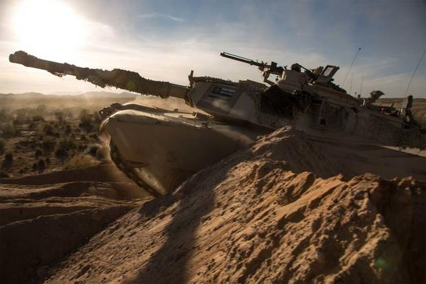 An M1A2 Main Battle Tank breaches through obstacles during the Army Warfighting Assessment (AWA) 17.1 at Fort Bliss, Texas, Oct. 21, 2016. (U.S. Army Photo/Pfc. Frederick Poirier)